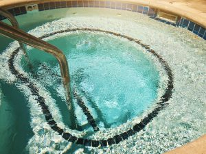 Outdoor Jacuzzi Pool With Fresh Blue Water For Massage And